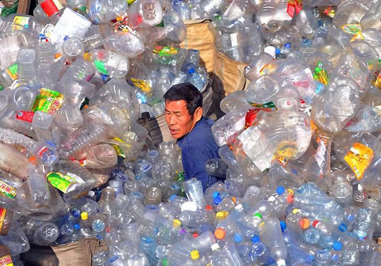 A man stuck in mountain of Bottled Water killing the enviroment