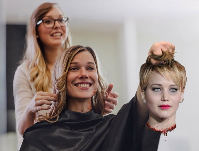 Woman Shows Hairstylist Example of Haircut 2f4h7